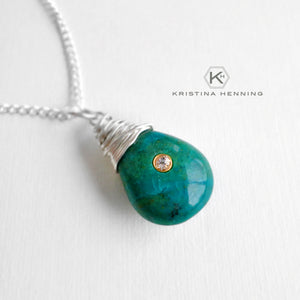 Chrysocolla wrapped stone pendant necklace in silver