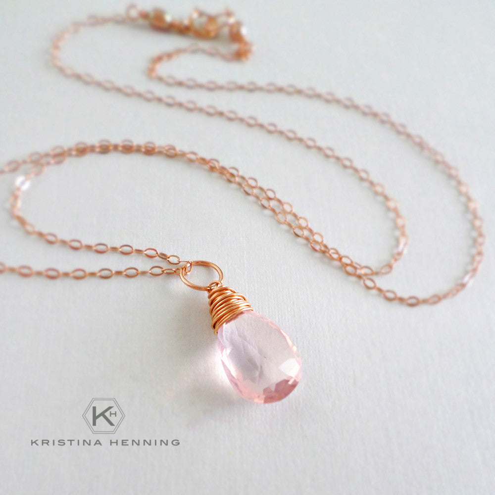 Rose quartz and gold wrapped stone necklace