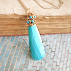 Sleeping Beauty turquoise and gold wrapped stone pendant necklace