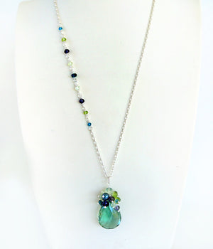 Sterling silver necklace with blue, green and teal gemstones and teal topaz pendant