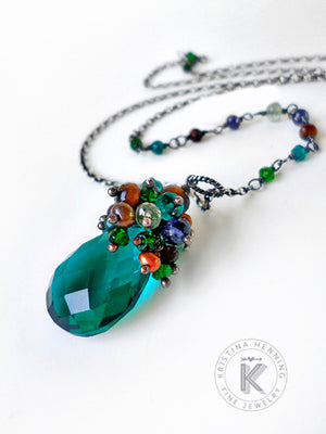 Pretty Palette Necklace in peacock teal, emerald green, navy blue  and caramel brown gemstones with oxidized sterling silver
