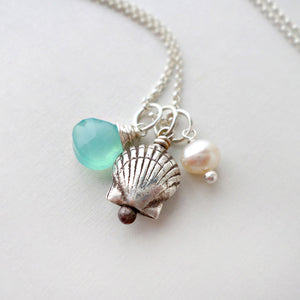 beach inspired jewelry with silver sea shell charm, sea blue chalcedony, and white pearl