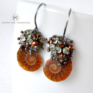 Ammonite fossil earrings with green and brown gemstones