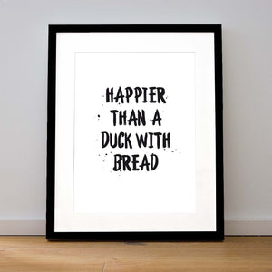 HAPPIER THAN A DUCK WITH BREAD