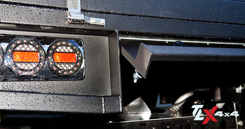Lockable under tray storage hinged rear cover behind the licence plate
