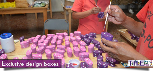 worry dolls boxes on pink and purple