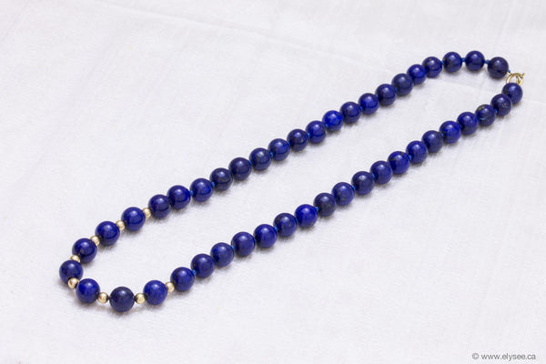 10.00 mm lapis bead necklace.