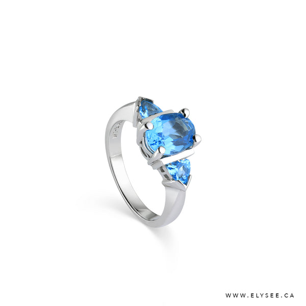 Blue Topaz Ring set in 14K White Gold, Topaz and White Gold Ring Bijouterie Élysée - Your Montreal jewellery designer.