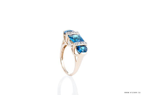 14K Yellow gold ring set with london blue topaz and diamonds. Montreal jewellery designer www.elysee.ca