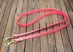 Bright pink and brass dog leash in biothane. Waterproof walk two dogs at once