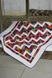 This is a fast and easy quilt pattern that you will have fun making. Confetti Steps uses one strip set, jelly roll or scraps from your stash to make a colorful quilt.