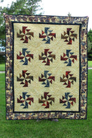 Crystals Swirls is a fast and easy quilt pattern that uses just one simple block set on point in a grass field