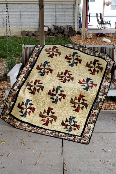 Crystals Swirls is a fast and easy quilt pattern that uses just one simple block set on point, on a swing