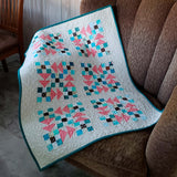 Flying Nines baby quilt on chair