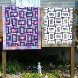 Hopscotch quilt pattern shown in two different colorways made with jelly rolls