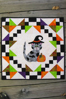 Kitty Kitty a cute applique quilt pattern, that has full size applique templates and full color diagrams to walk you through each step of the quilt.