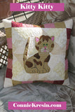 Kitty Kitty a cute applique quilt pattern, that has full size applique templates and full color diagrams to walk you through each step of the quilt.  Can also be made into a pillow