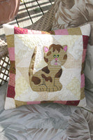 Makes a cute pillow! Kitty Kitty a cute applique quilt pattern, that has full size applique templates and full color diagrams to walk you through each step of the quilt.