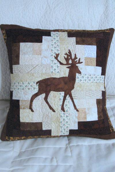 Applique deer on a log cabin block pillow that is 16 x 16