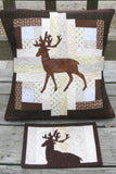 Applique deer on a log cabin block pillow that is 16 x 16 and a mug rug