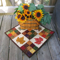 Modern Nine Patch quilt pattern with maple leaf applique