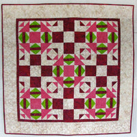 The quilt pattern uses two different blocks and one of them has a section that is done with either templates (included in the pattern) or by paper piecing with foundation paper.