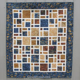 Scattered quilt pattern is fast and easy to make using bold and beautiful batiks or other fabrics for the blocks