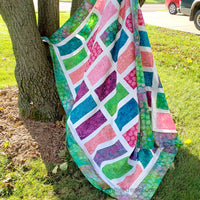 Sparkles quilt in bright colorful fabrics