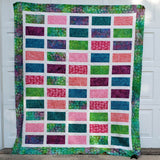 Sparkles quilt in bright colorful fabrics flat view