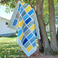 Sparkles quilt pattern in blue and yellow batiks