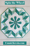 Spin the Wheel quilted wall hanging pattern with applique in the center easy to make