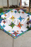 Crystals Swirls is a beautiful quilt made with just one simple block made in two different sizes.