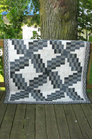 Swirly quilt pattern can be made in just one day! It uses 5 coordinating fabrics and a neutral.