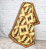 Tassel quilt on ladder by brick wall quilt pattern