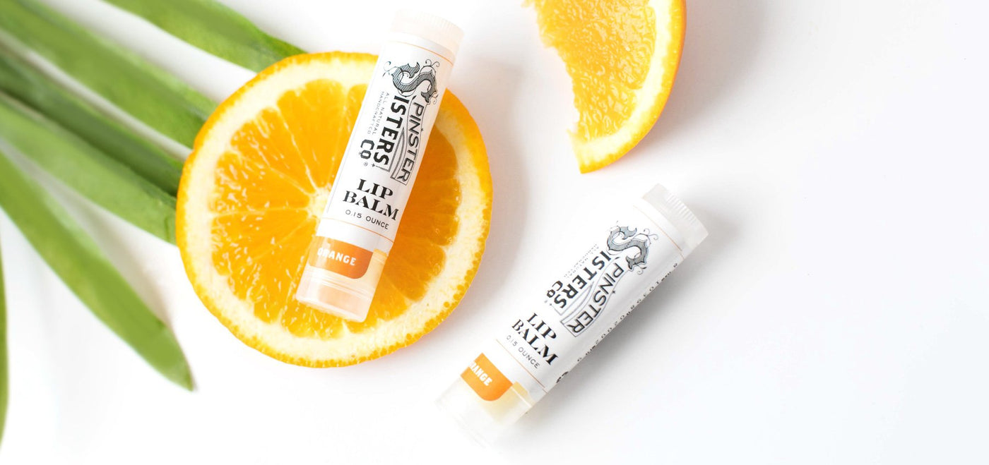 two lip balms with orange slices