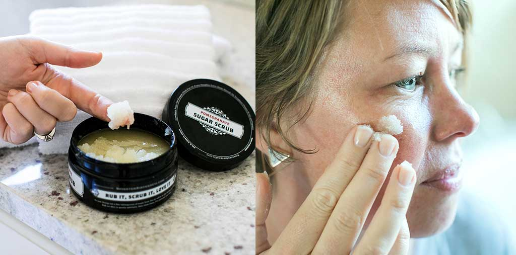 The woman dips her finger in Sugar Scrub and applies it to face