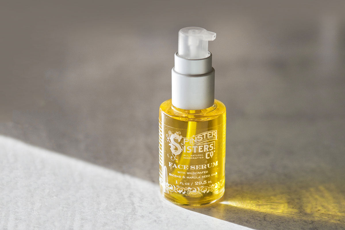 Bright yellow oil-based face serum with baobab and marula seed oils