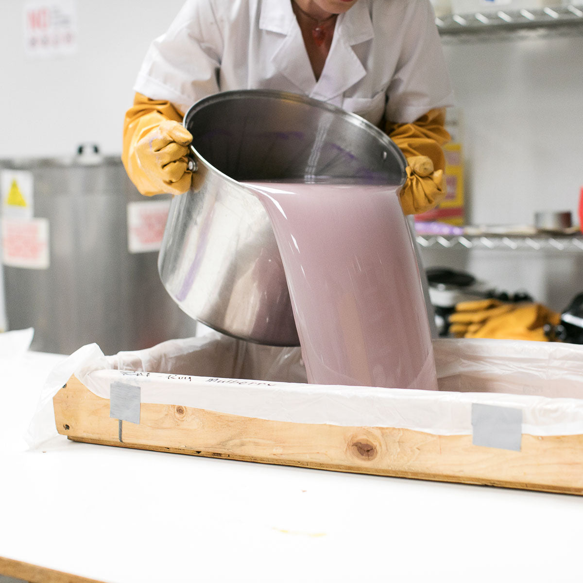 Bar soap mixture being poured into the mold
