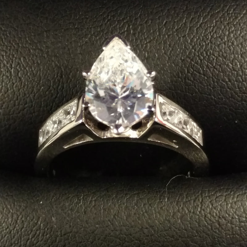 *Clearance* Cubic Zirconia Engagement Ring- The Audra (Pear Cut Center and 7-stone Princess Channel in Palladium)