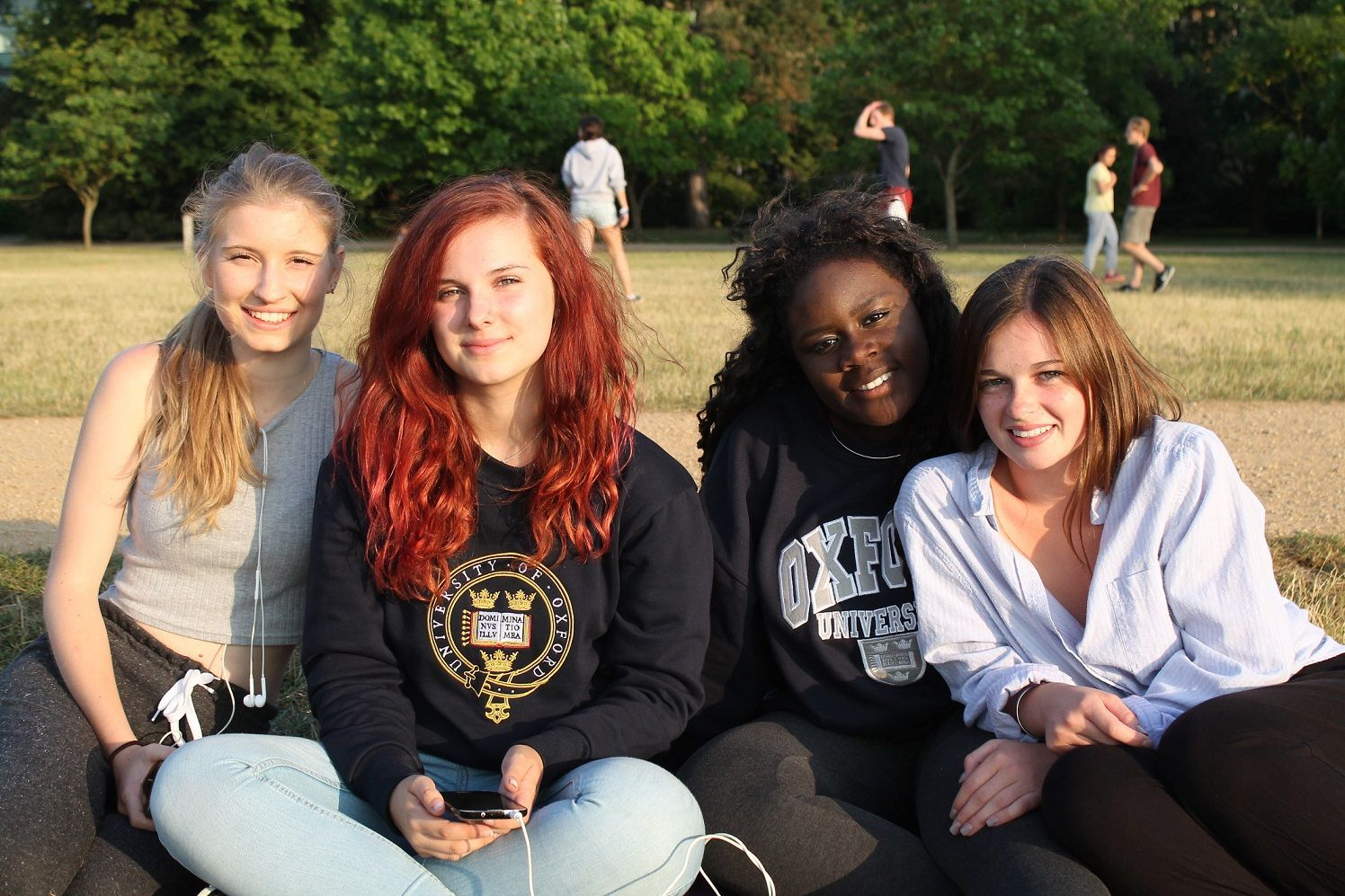 Four summer school students in Oxford University Parks