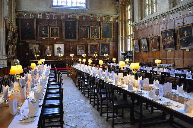 Oxford university formal dinner laid out in hall