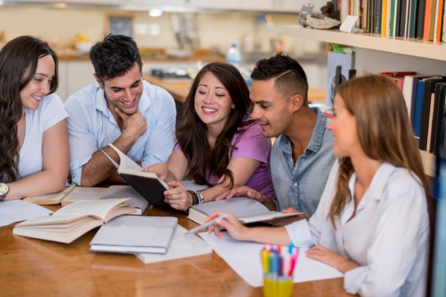 International students revising for university exams with friends