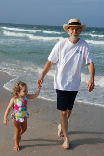Sheli's Father walking down the beach with Sheli's Daughter