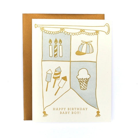 Stock photo of letter pressed card of Happy Birthday Baby Boy card with gold envelope