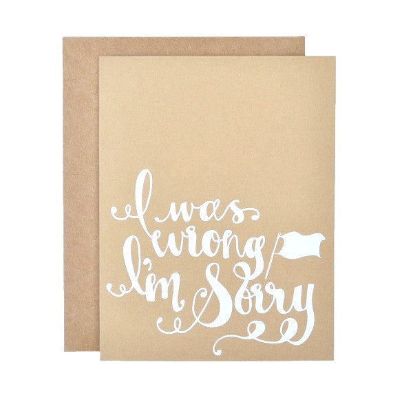 "Stock image of screen printed brown kraft card with white font saying ""I was wrong I'm sorry"""