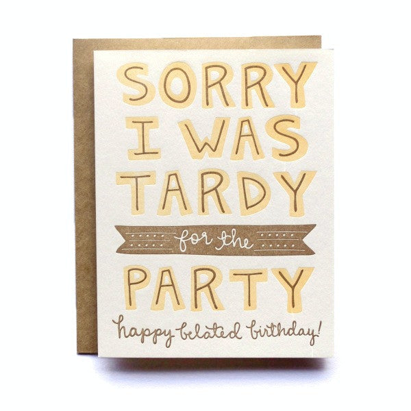 "Stock image of letterpress card with text saying ""Sorry I was Tardy for the Party, Happy Belated Birthday"" card with brown envelope"