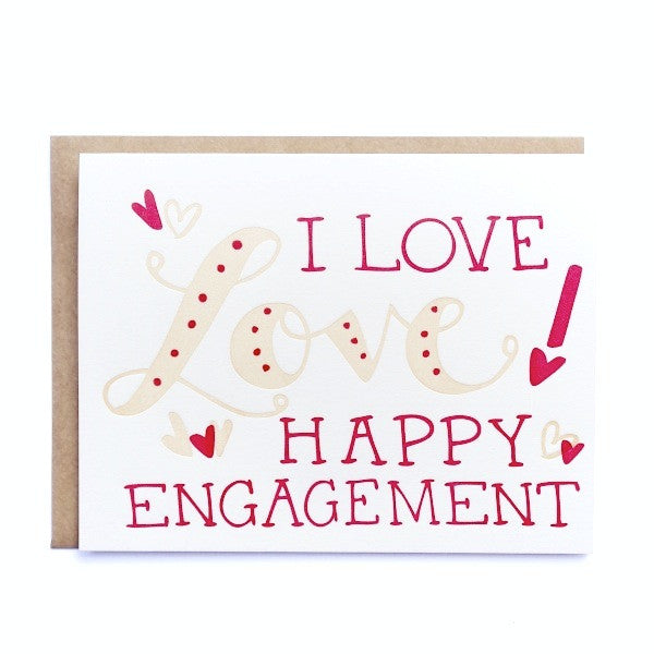 stock photo of letterpress card with I love Love! Happy Engagement written on the front with brown envelope