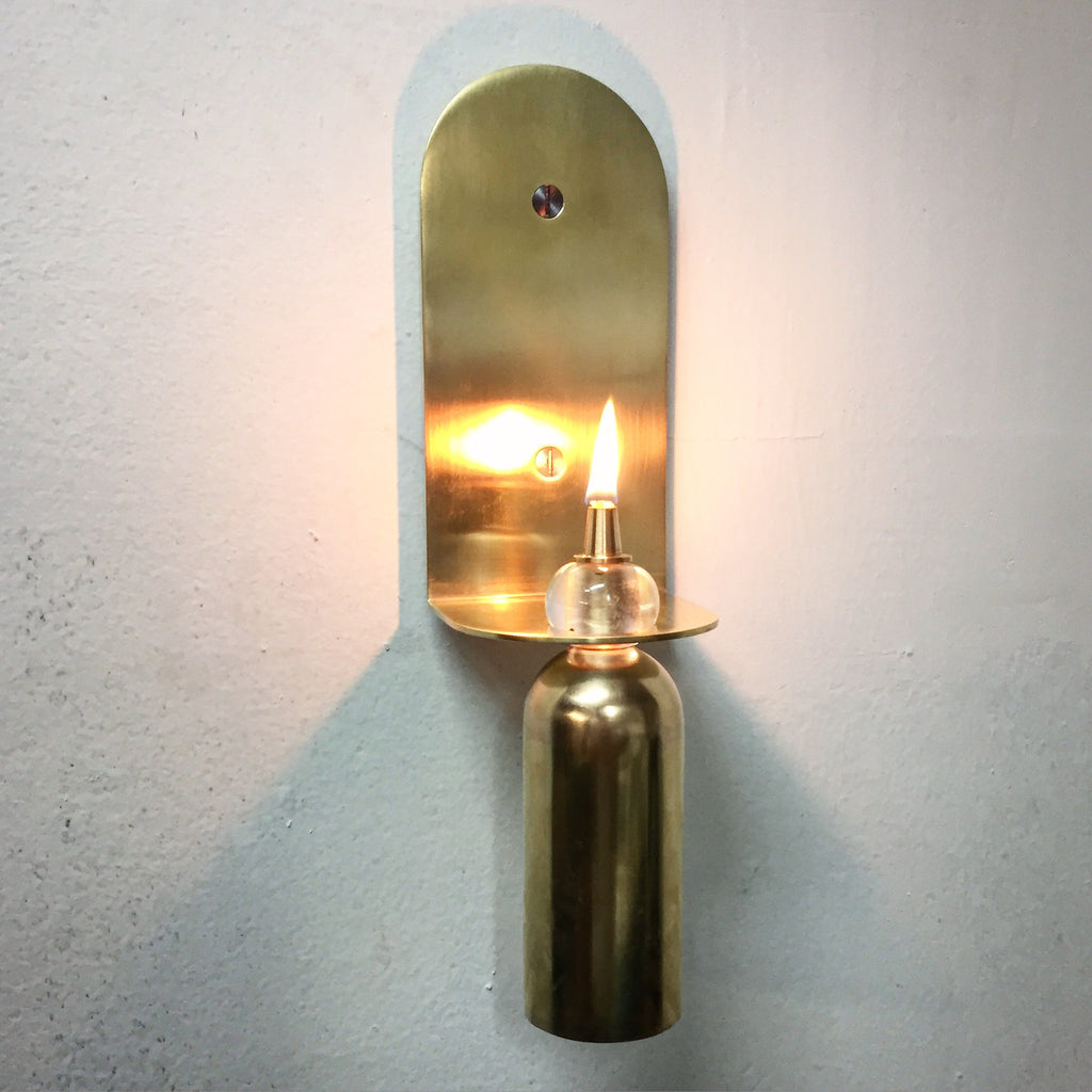 Gimballed oil sconce