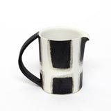 white windowpane pitcher by Theresa Choi