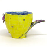 "Yellow Grid and Flowers Mugs by Chanakarn ""Punch"" Semachai"